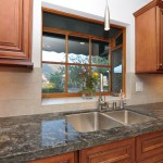 Stainless steel kitchen sink under bay window