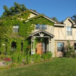 Newly designed and renovated Exterior of English Country style cottage with greenery landscape
