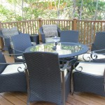 Exterior wood deck sitting area with patio chairs and table