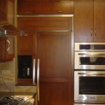 Built-in refrigerator, wood cabinetry and stainless steel appliances