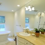 simple clean remodeled bathroom design with freestanding bath tub
