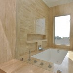 Modern stone shower and bathtub