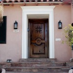 A spanish style wood front door with ironwork