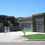 a modern home with metal and glass garage doors