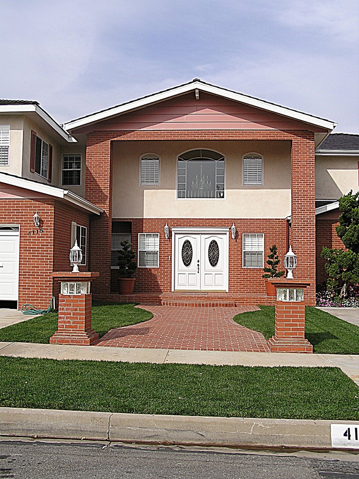 Neo Colonial Home With Brick And Stucco Exterior