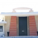 a midcentury home with egyptian inspired pylon front door