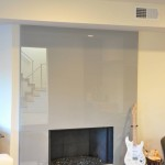 Modern glass fireplace with gray color