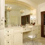 Neoclassical bathroom, white cabinets, white counter top wall mirror and chandelier