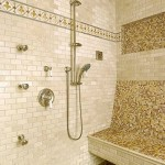 Interior of shower with tiled walls and tiled bench and decorative mosaic