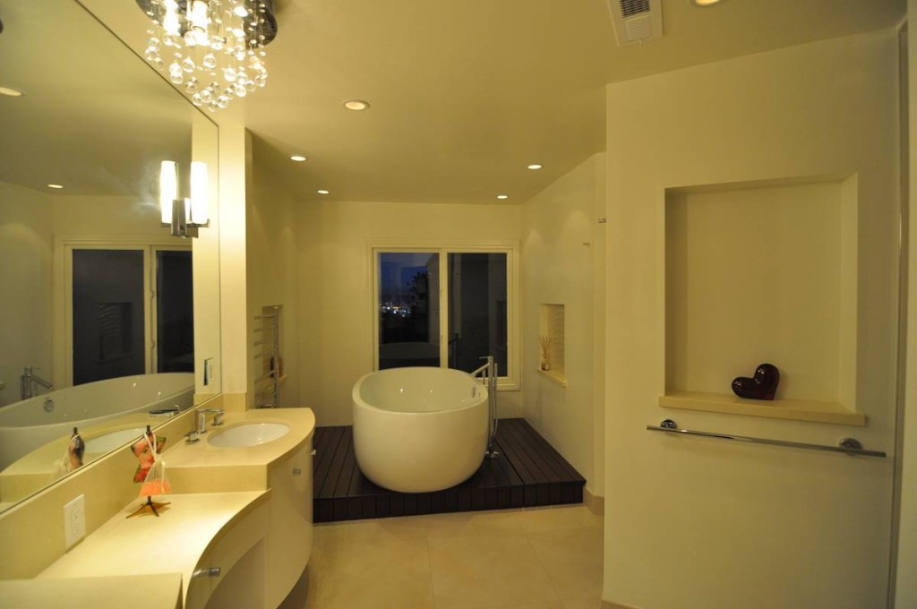 The idea of mounting a crystal chandelier in the form of balls of a modern bathroom