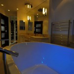 Contemporary bathroom, white tub with glowing blue light