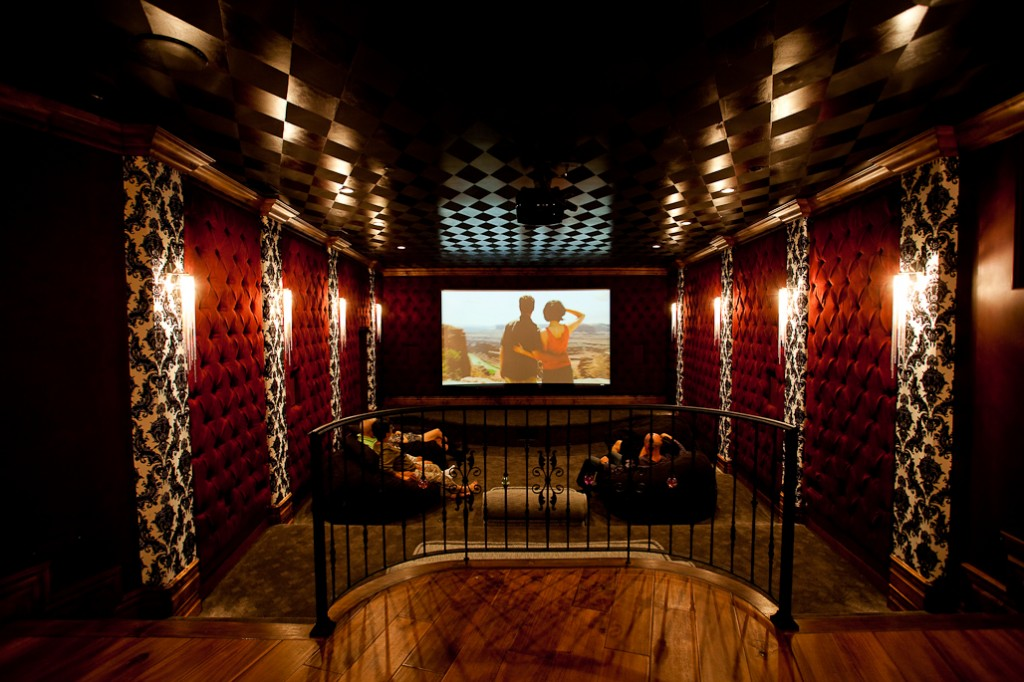 Home Theater With Red Upholstery On The Walls White And Black Wall Paper  And Painted Ceiling