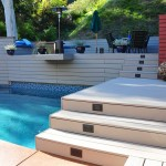 Grey Trex Deck with sitting area above the pool