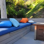 Grey Trex deck with trex bench covered with soft pillows