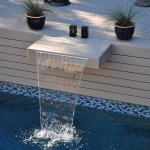 Waterfall attached to trex deck flowing into the pool
