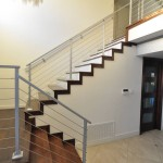 Modern stairway with wood staircase and metal railing